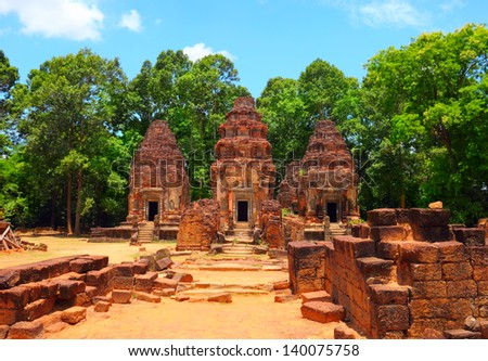 SIEM REAP/CAMBODIA - MAY 03. Beautiful scenic view of ruined Preah Ko Wat on may 03, 2013 in Roulos, Siem Reap, Cambodia. Roulos temples is the most ancient building in Angkor archaeological complex. - stock photo