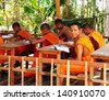 SIEM REAP/CAMBODIA - MAY 06. Group of young buddhist monks studies at classroom in Lolei monastery on may 06, 2013 in Lolei temple, Cambodia, Indochina. - stock photo