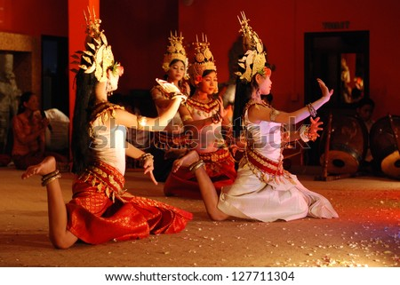 SIEM REAP, CAMBODIA - MAY 3 : Khmer classical dancers performing in full traditional costume May 3, 2009 in Siem Reap, Cambodia.Angkor Wat is the most visited place in Cambodia. - stock photo