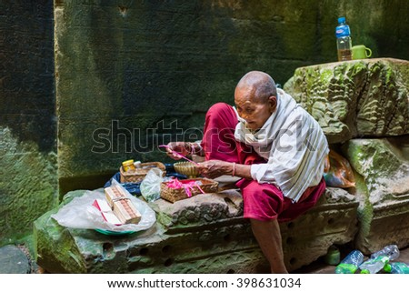 Siem Reap, Cambodia, 14 Nov 2015: Famous elderly nun at Preah Khan Temple waiting for visitors. - stock photo