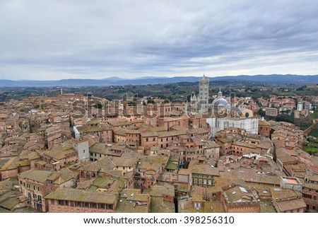 Siena Cathedral (Duomo di Siena), a medieval church in Siena, Italy. View from the Campanile (tower) del Mangia. - stock photo