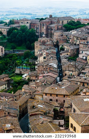 Siena. Image of ancient Italy city, view from the top. Beautiful house and chapel. - stock photo