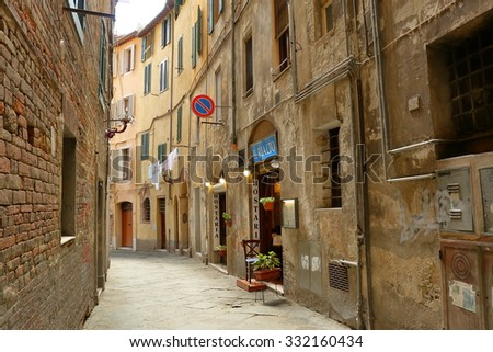 Siena, Italy - August 20, 2015: View of the ancient streets and buildings in Siena, Italy