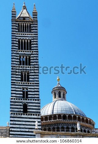 Siena, Italy, bell tower and dome of the cathedral D - stock photo