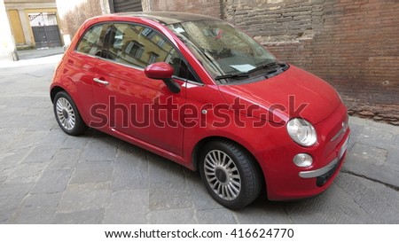 SIENA, ITALY, - CIRCA APRIL 2016: red FIAT 500 car (new version) parked on a street in the city centre