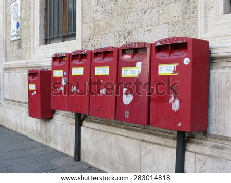 SIENA, ITALY - CIRCA DECEMBER 2014: row of letter box mailboxes for sending mail - stock photo