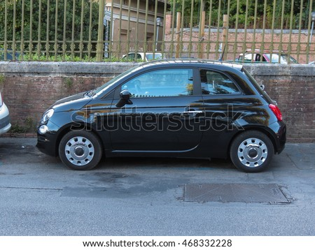SIENA, ITALY - CIRCA JULY 2016: black Fiat New 500 car parked in a street of the city centre