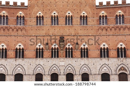 Siena, Italy; Facade of Palazzo Pubblico - stock photo