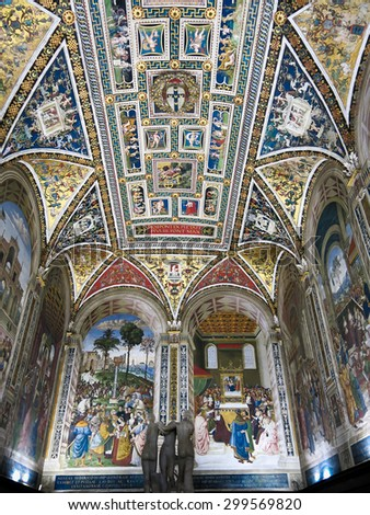 SIENA, ITALY - JULY 27, 2013: Interior of Duomo di Siena or Siena Cathedral.  Piccolomini Library with frescoes painted by Umbrian Bernardino di Betto, called Pinturicchio