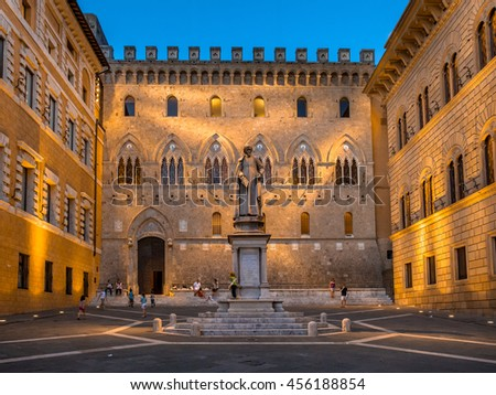 SIENA, ITALY-JULY 14, 2016: Square with Statue and Palace on background on Piazza Salimbeni, Monte dei Paschi di Siena bank
