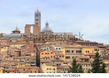 Siena, Italy - medieval town of Tuscany. Cathedral aerial view.