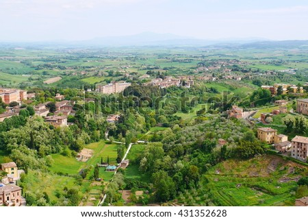 Siena, Tuscany Valley. Italy countryside landscape with grassy hills, houses, forests, vineyards and olive trees - stock photo