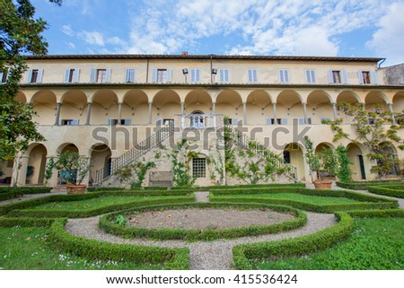 SIENNA, ITALY - MAY 01, 2016 - Tuscan villa with arches and landscaped garden green in the Chianti hills