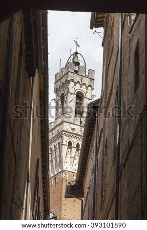 Sienna, Torre del Mangia (Palazzo Pubblico) at the Piazza del Campo, Tuscany, Italy - stock photo