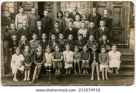 SIERADZ, POLAND, CIRCA THIRTIES - Vintage photo of group of school pupils and their tutors - stock photo