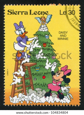 SIERRA LEONE - CIRCA 1992: A stamp printed by Sierra Leone, shows Walt Disney Characters in Christmas Scenes, circa 1992. - stock photo