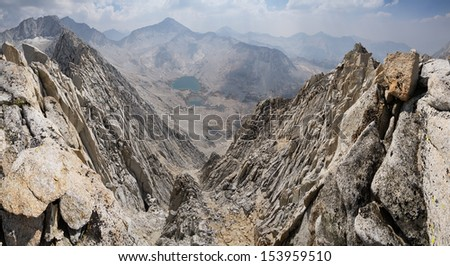 Sierra Nevada mountain ridge panorama with mount Mills and Gabb on a smoky day - stock photo