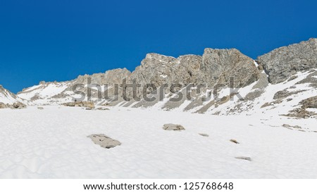 Sierra Nevada Snow Scenery. Endless snowfields leading up to the rugged Forester Pass, California, USA. - stock photo