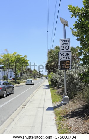 SIESTA KEY, FLORIDA - MAY 9, 2013: Your Speed, vehicle speed detector sign showing current car speed that just passed and posted regular speed limit on top just outside Siesta Beach on a sunny day.   - stock photo
