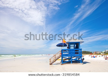 SIESTA KEY, FLORIDA USA-OCTOBER 4, 2013: Blue lifeguard house in Siesta Key on the west coast of Florida. Famous for pristine white sand beaches and sunny weather it attracts visitors all year round - stock photo