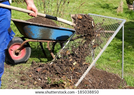 Sieving the composted earth - stock photo