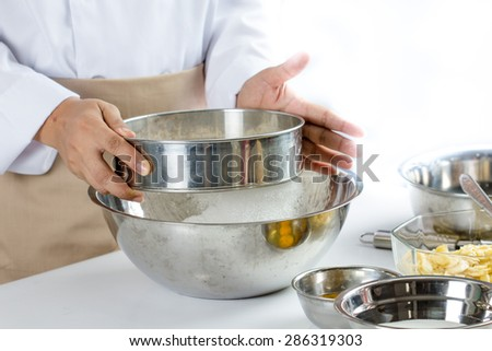 sifting flour for making bakery in kitchen room