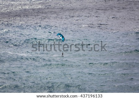 Siggiewi, Malta - May 04, 2016: The view from the cliffs on the kiteboarder. Malta island in Mediterranean Sea.