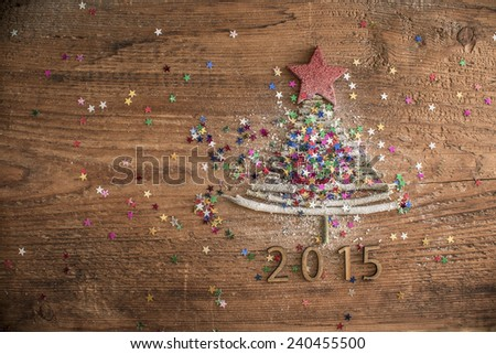 Sigh symbol from many dry Stick Christmas green Tree a lot colorful star toys on old retro vintage style wooden texture background Empty copy space for inscription Idea of merry new year 2015 holiday - stock photo
