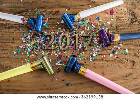 Sigh symbol from number 2017 in confetti, streamers on old retro vintage style wooden texture background Empty copy space for inscription Idea merry new year holiday year of cock - stock photo