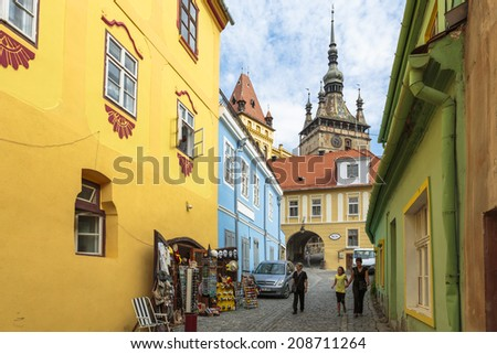 SIGHISOARA, ROMANIA - JULY 26, 2014: Unidentified tourists visit the medieval citadel of Sighisoara, listed by UNESCO as World Heritage Site. Vlad Tepes (Dracula) was born here in 1431. - stock photo