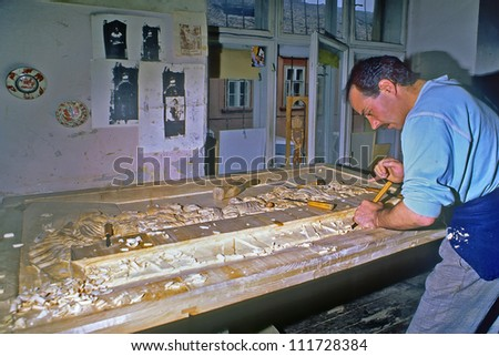 SIGHISOARA, ROMANIA - JUNE 3: Romanian sculptor works on part of wooden altar on June 3, 1997 in Sighisoara, Romania. Those sculptor represents traditional culture in Romania. - stock photo