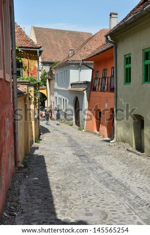 SIGHISOARA, ROMANIA � JUNE, 28: Tourists visiting Sighisoara (Schassburg, Segesvar), the only inhabited medieval citadel in Europe, part of UNESCO heritage. On June 28, 2013, in Sighisoara, Romania