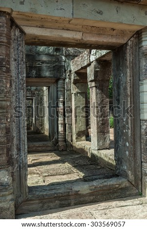 sight of the ruins of a library in the archaeological place ta keo in siam reap, cambodia