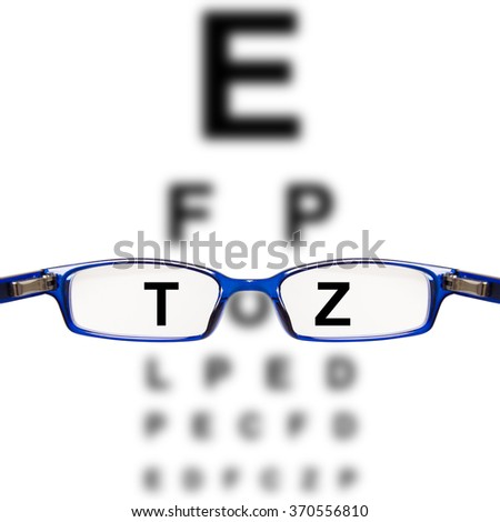 sight test seen through eye glasses - white background isolated