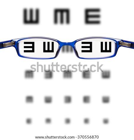 sight test seen through eye glasses - white background isolated - stock photo