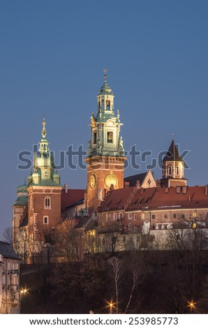 Sigismund, Clock and Silver Bells towers of the St Stanislaw and St Vaclav on the Wawel Hill with the fortifications of the Wawel castle in the night