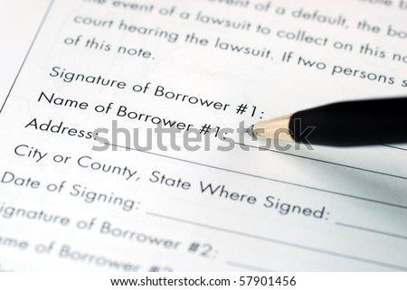 Sign and fill in the name for the borrower - stock photo