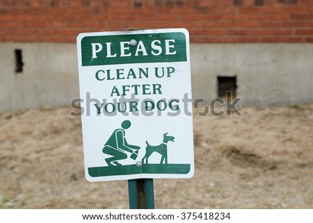 Sign asking dog owners to clean up after their pets.