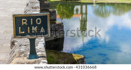 Sign at the roman bridge in Ponte de Lima, Portugal - stock photo