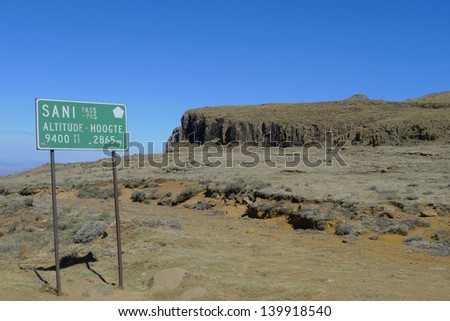 Sign at the Sani Pass between South Africa and Kingdom of Lesotho. Sani Pass ends at the altitude of 9400 feet or 2865 meters - stock photo