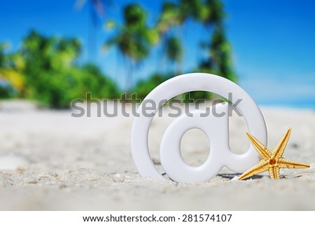 sign at with starfish on the beach. Travel concept