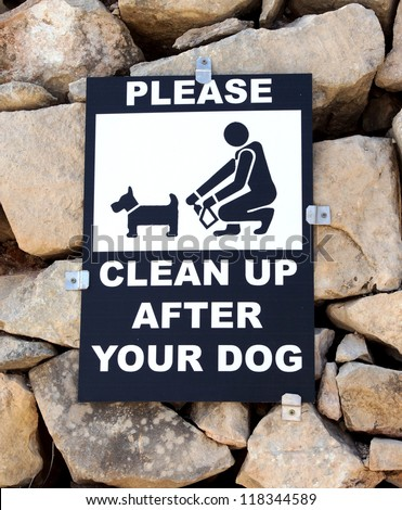 sign / board saying you must clean up after your dog