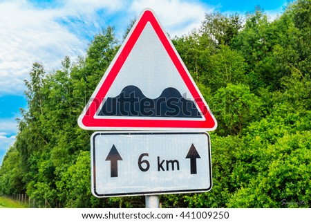 Sign bumpy road - stock photo
