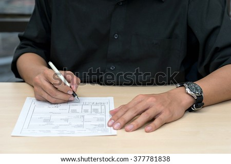 sign contract and approve document on desk - stock photo