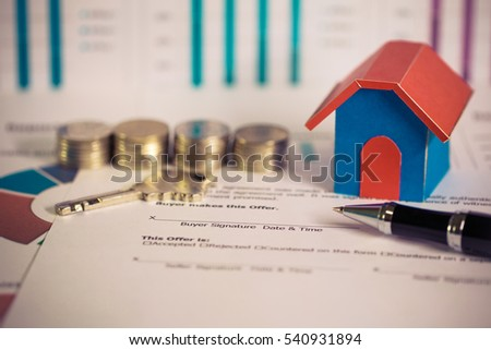 Sign contract loans for real estate, buying a new home and realty owner concept.