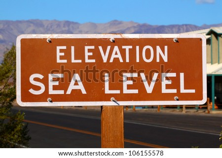 Sign denoting Elevation at Sea Level in the Stovepipe Wells Village of Death Valley National Park - stock photo