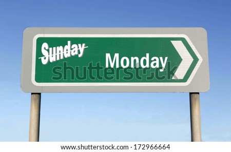 Sign depicting the change from Sunday to Monday, with the word Sunday crossed out - stock photo