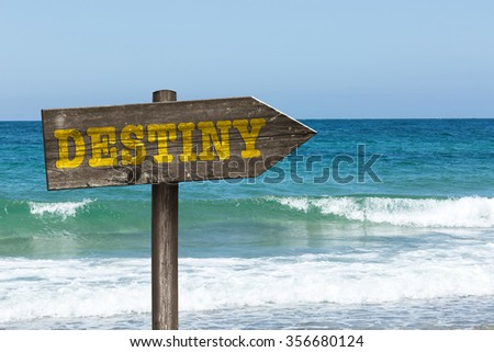 sign destiny on the background beach and sea