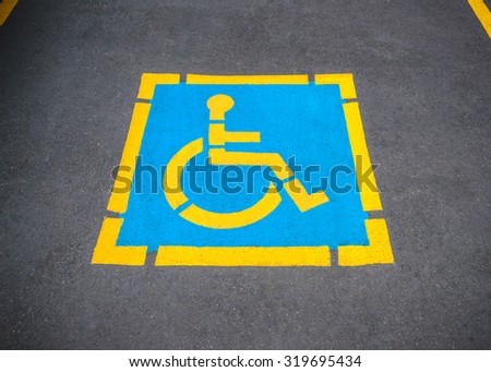 Sign disabled or handicapped, detail of a signal in a parking support - stock photo
