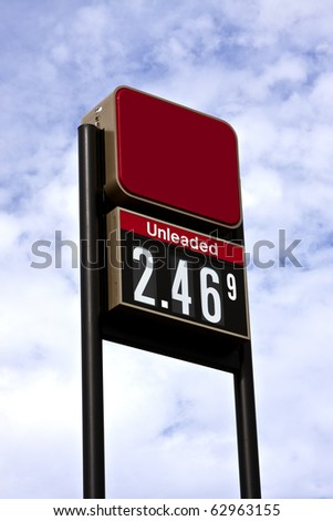 sign displaying gas pricing at a service station - stock photo